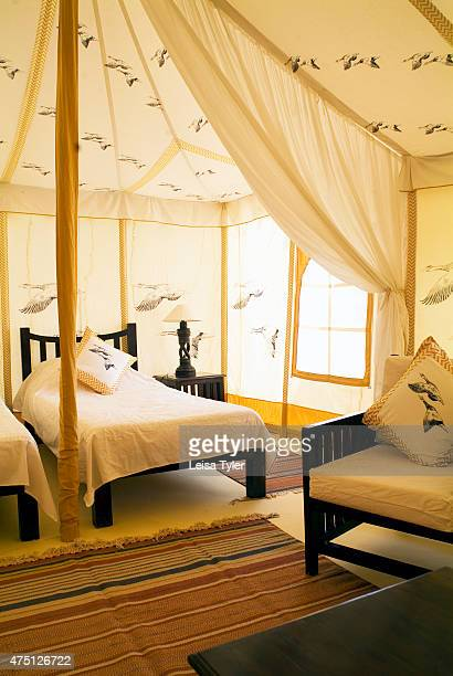 The interior of a guest tent at Ramathra Fort Hugging a hillside in the remote farming land of Karauli the imposing ruins of Ramathra Fort with meter...