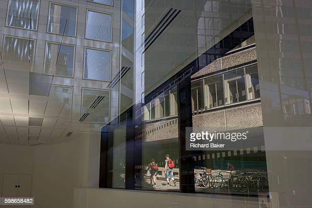 The interior of a vacant office with reflections of nearby architecture and Pudding Lane the location where the Great Fire of London of 1666 started...
