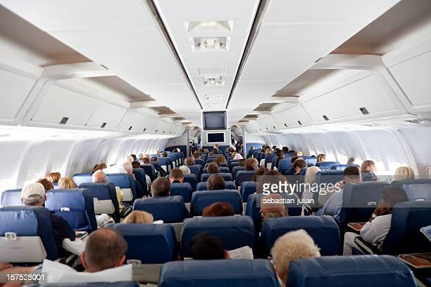 The interior of an airplane with passengers