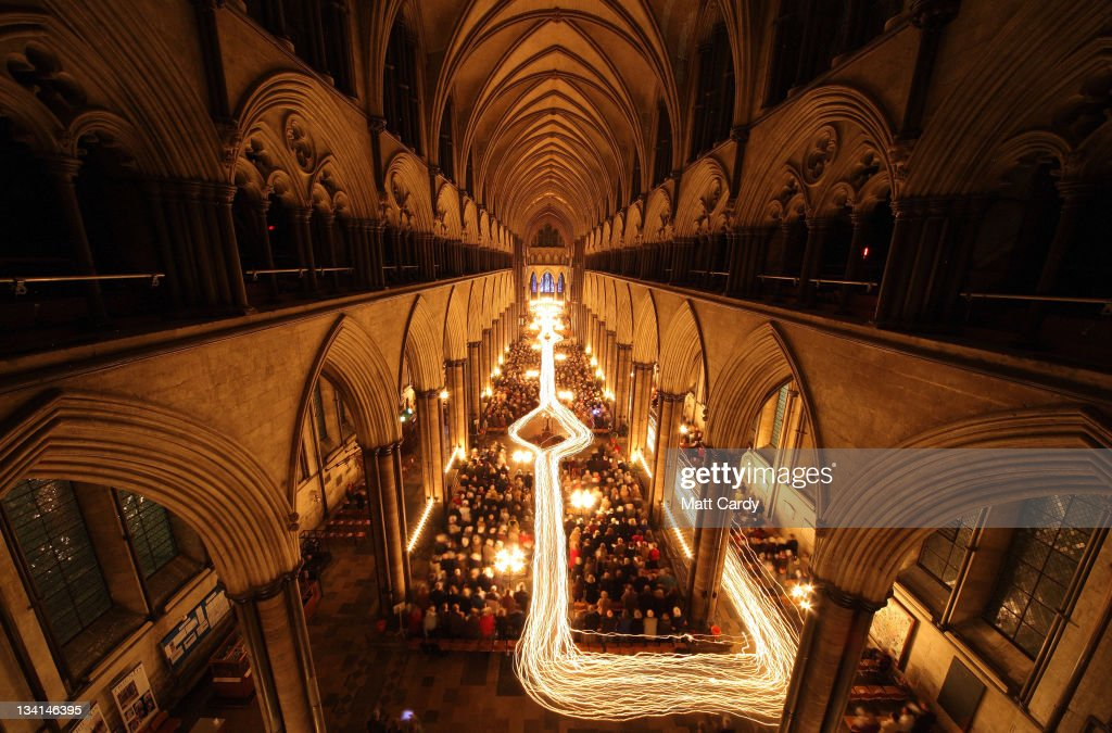 The interior of Salisbury Cathedral is illuminated by trails of candles carried by choristers during the annual 'darkness to light' advent procession on November 25, 2011 in Salisbury, England. The service - which begins with the medieval cathedral in total darkness and silence before the Advent Candle is lit at the West End -is one of the most popular services of the liturgical year. The annual advent service, which takes place over three nights, is a mix of music and readings during which two great candlelit processions move around the different spaces in the 750-year-old building which, by the end, is illuminated by almost 1300 candles and is a spectacular start to the Christmas season.