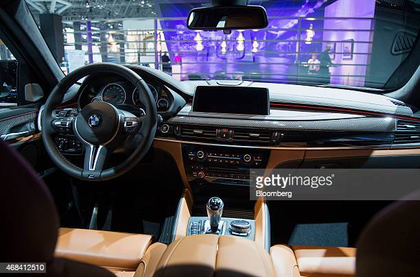 The interior of the Bayerische Motoren Werke AG X6M sports utility vehicle is seen during the 2015 New York International Auto Show in New York US on...