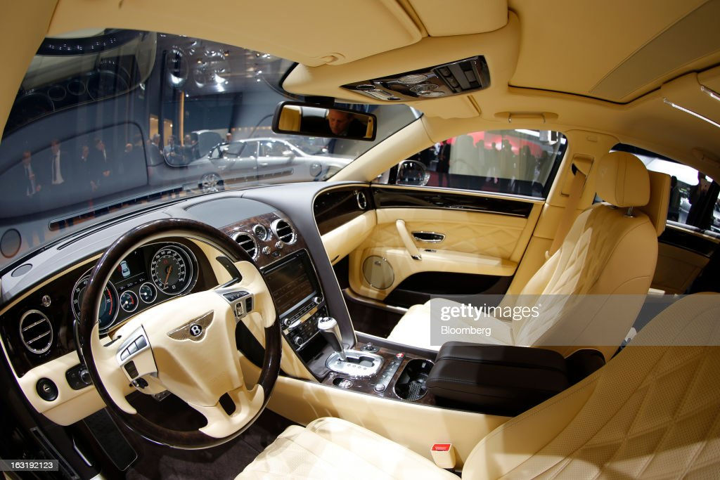 The interior of the Bentley Flying Spur automobile, produced by Bentley Motors Ltd., a luxury unit of Volkswagen AG (VW), is seen on display on the first day of the 83rd Geneva International Motor Show in Geneva, Switzerland, on Tuesday, March 5, 2013. This year's show opens to the public on Mar. 7, and is set to feature more than 100 product premiers from the world's automobile manufacturers. Photographer: Valentin Flauraud/Bloomberg via Getty Images