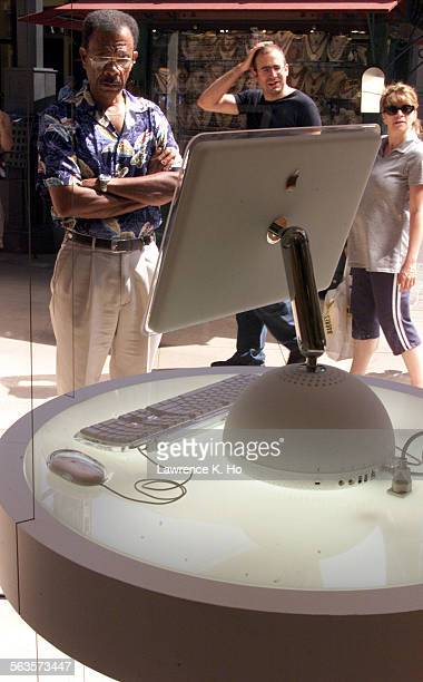 The interior of the brand new unique Apple Store at the Grove shopping center Pic shows passerby looking at the storefront display