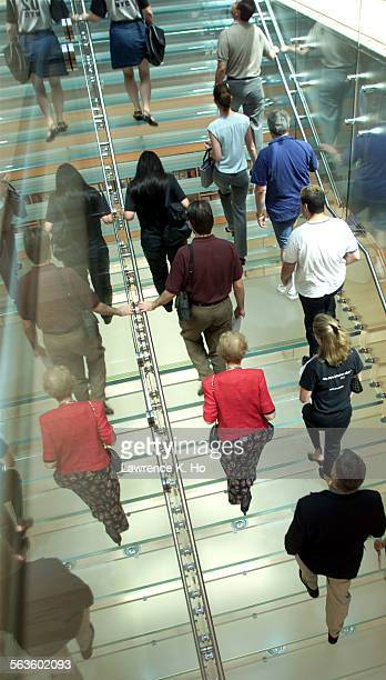 The interior of the brand new unique Apple Store at the Grove shopping center Pic shows a tour going up the glass staircase