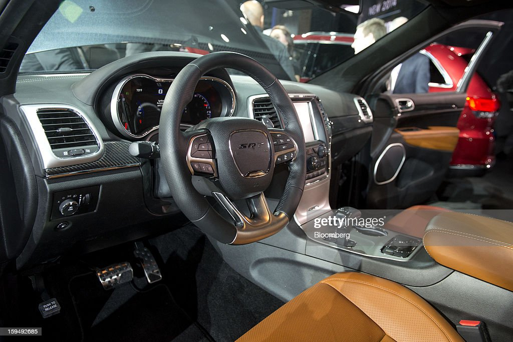 The interior of the Chrysler Group LLC 2014 Jeep Grand Cherokee SRT is seen during the 2013 North American International Auto Show (NAIAS) in Detroit, Michigan, U.S., on Monday, Jan. 14, 2013. The Detroit auto show runs through Jan. 27 and will display over 500 vehicles, representing the most innovative designs in the world. Photographer: Daniel Acker/Bloomberg via Getty Images
