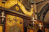 The interior of the church. Icons, chandelier, candles in a small Christian Orthodox church in Montenegro.