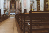 The interior of the church with benches.