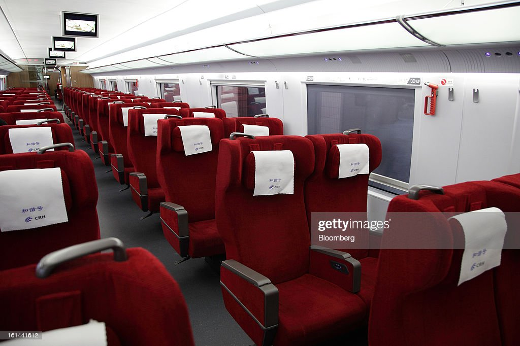 The interior of the first class car of a China Railways high speed train is seen at Hongqiao Railway Station in Shanghai, China, on Friday, Feb. 8, 2013. A record 3.41 billion passenger trips may be made this year during the Lunar New Year period, according to the National Development and Reform Commission. Photographer: Tomohiro Ohsumi/Bloomberg via Getty Images