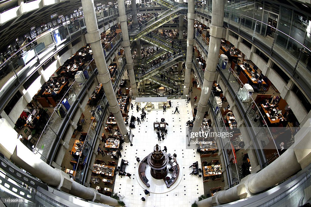 The interior of the Lloyd's of London building and the Lutine bell center is seen through a fisheye lens in the City of London UK on Tuesday March 27...