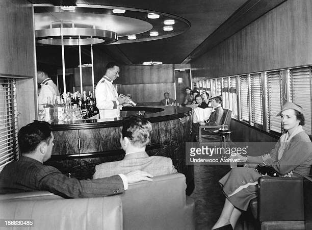 The interior of the lounge car on the New York Central Railroad's new streamlined Mercury train Detroit Michigan 1936 The train was designed by noted...
