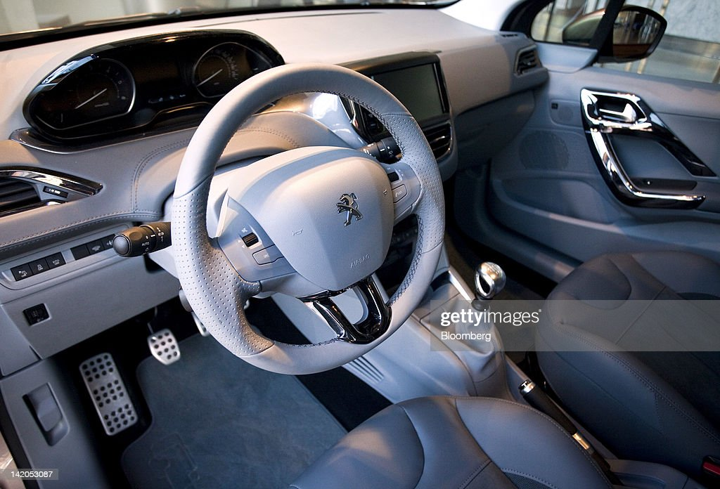 The interior of the new Peugeot 208 automobile, produced by PSA Peugeot Citroen SA, is seen on display at the company's headquarters in Paris, France, on Wednesday, March 28, 2012. PSA Peugeot Citroen SA, Europe's second-biggest carmaker, seeks leadership in the region's small-car segment with its new 208 model. Photographer: Balint Porneczi/Bloomberg via Getty Images