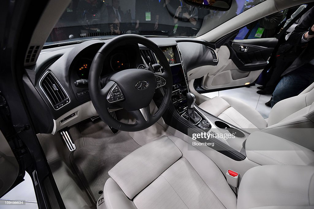 The interior of the Nissan Motor Co. Infiniti Q50 sedan is seen after being unveiled during the 2013 North American International Auto Show (NAIAS) in Detroit, Michigan, U.S., on Monday, Jan. 14, 2013. Nissan Motor Co.'s Infiniti, lagging larger German, Japanese and U.S. luxury brands, is replacing the G sedan with the Q50 sports car as the company links growth goals for its rechristened lineup to better looks and technology. Daniel Acker/Bloomberg via Getty Images