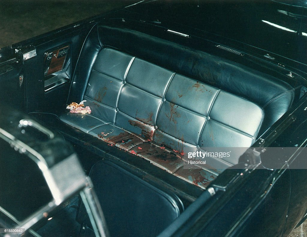 The interior of the Presidential limousine after the Kennedy assassination. Included as an exhibit for the Warren Commission. Ca. November, 1963.
