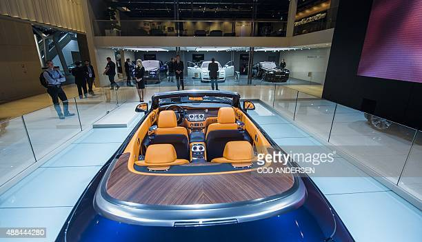 The interior of the RollsRoyce Dawn convertible is presented at the booth of the British carmaker during a press day of the 66th IAA auto show in...