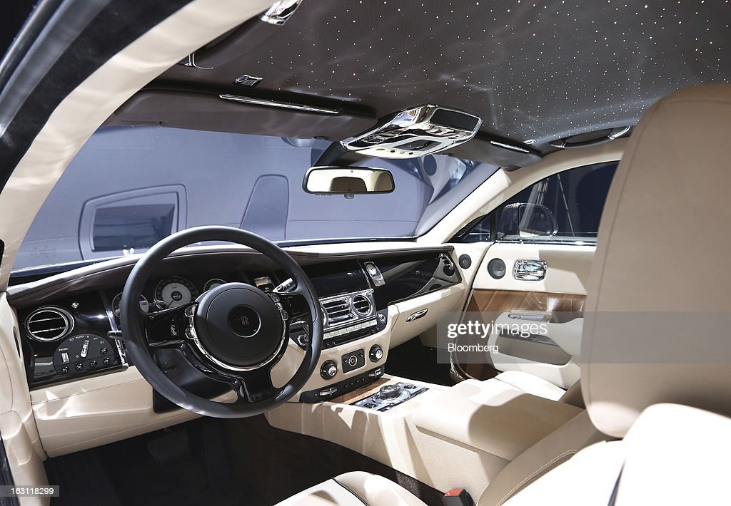 The interior of the Rolls-Royce Wraith automobile, produced by Rolls-Royce Motor Cars Ltd., is seen ahead of the opening day of the 83rd Geneva International Motor Show in Geneva, Switzerland, on Monday, March 4, 2013. This year's show opens to the public on Mar. 7, and is set to feature more than 100 product premiers from the world's automobile manufacturers. Photographer: Chris Ratcliffe/Bloomberg via Getty Images