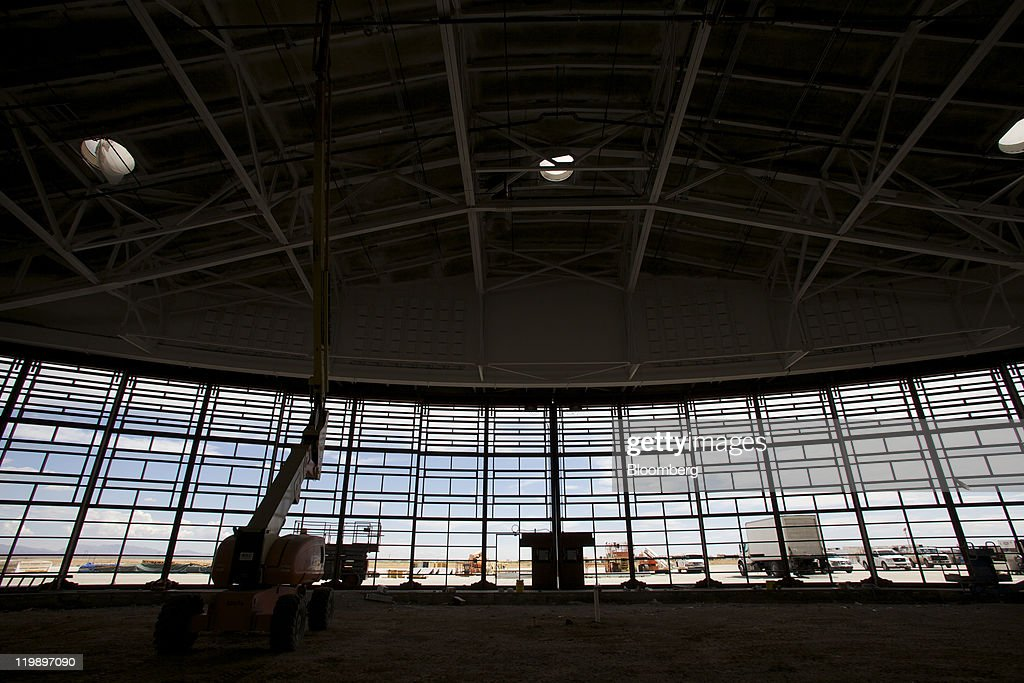 The interior of the Terminal Hangar Facility at Spaceport America is shown in Sierra County, New Mexico, U.S., on Thursday, July 14, 2011. The future home of Virgin Galactic is behind schedule and its director says it won't generate as many jobs as backers once claimed. Photographer: Christ Chavez/Bloomberg via Getty Images