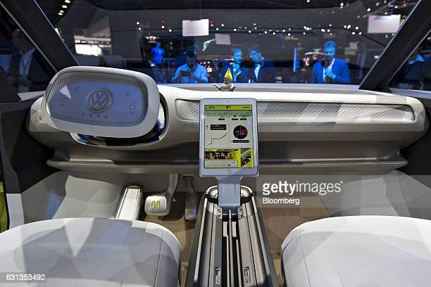 The interior of the Volkswagen AG ID Buzz concept vehicle is displayed during the 2017 North American International Auto Show in Detroit Michigan US...
