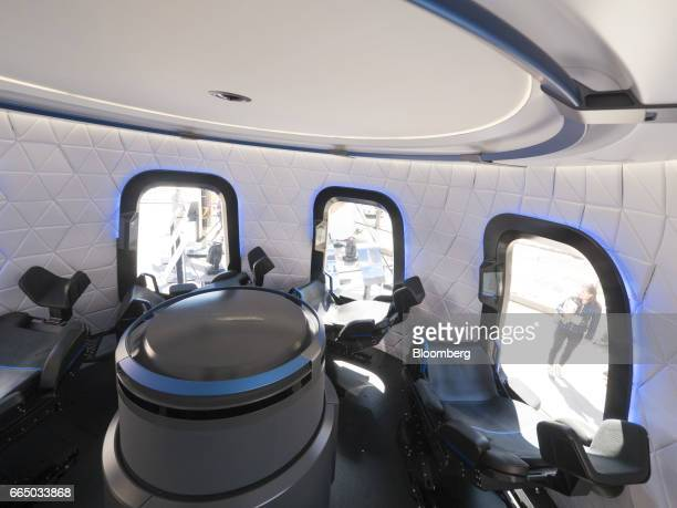 The interior the high fidelity crew capsule mock up of the Blue Origin LLC New Shepard system sits on display during the Space Symposium in Colorado...