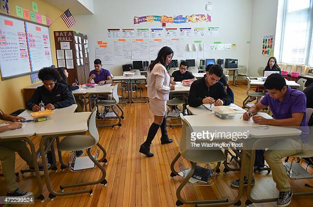 The International Academy math teacher Angelina Dialel walks through her class while giving instructions during geometry at Cardozo High School on...