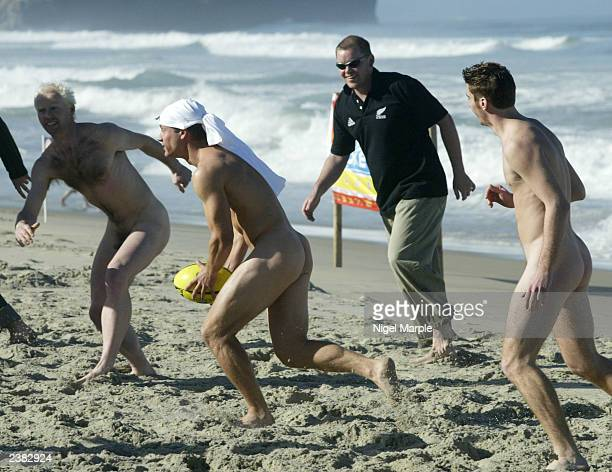 The International Barbarians Paul Mastersen runs against the Kiwi Selection during the International Nude Touch Rugby match at St Kilda's beach on on...