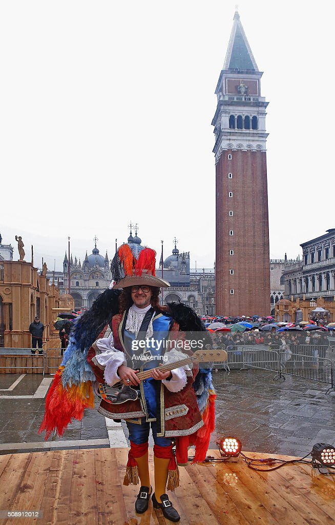 The international bass player Saturnino performs during the 'Volo dell'Aquila', as he flies down from San Marco Tower to the Square at Piazza San Marco on February 7, 2016 in Venice, Italy. The 2016 Carnival of Venice will run until February 9 and includes a program of gala dinners, parades, dances, masked balls and music events.