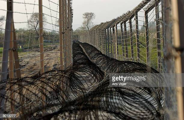 The International Border fence seperating India and Pakistan which is currently being built is pictured on February 25 2004 near Ahknoor India With...