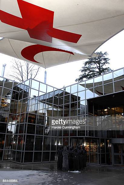 The International Committee of the Red Cross logos are hanging above the group of sculptures 'The Petrified' by Carl Bucher at the ICRC Museum on...