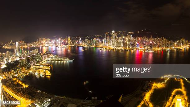 The International Finance Centre stands in Central District as Harbour City and Ocean Terminal in Tsim Sha Tsui are seen across the Victoria Harbour...