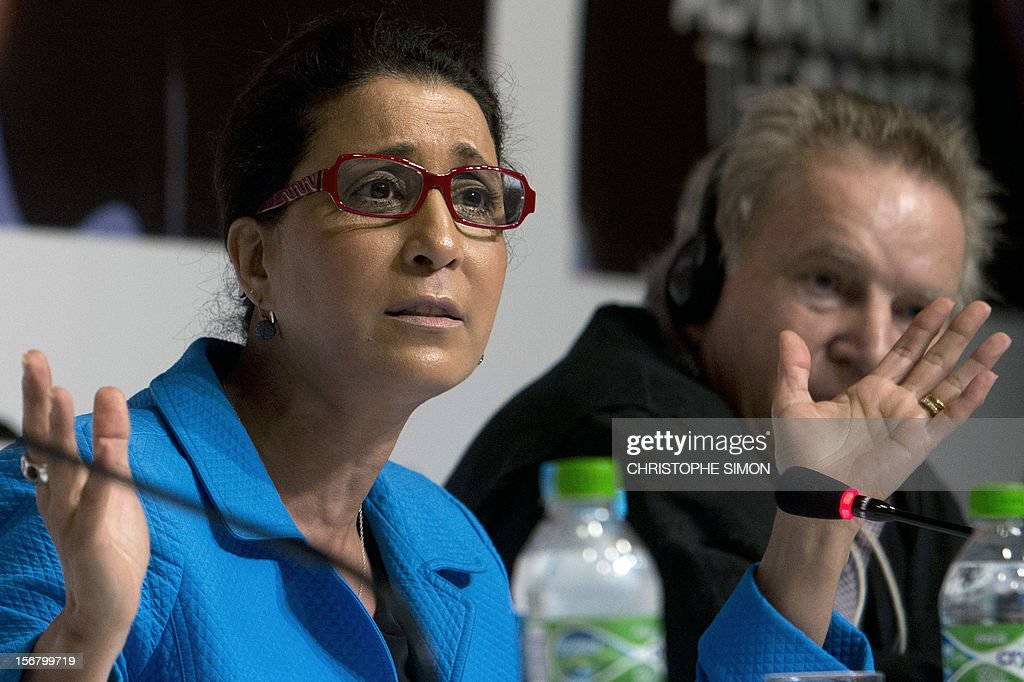 The International Olympic Committee (IOC) Vice-president and Chair of the IOC Coordination commission for Rio 2016, Moroccan Nawal El Moutawakel (L), delivers a speech during the debriefing of London 2012 Olympic Games for the foreign press, at Barra de Tijuca in Rio de Janeiro on November 21, 2012. AFP PHOTO / Christophe Simon