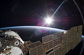 November 22, 2009 - The bright sun greets the International Space Station in this scene from the Russian section of the orbital outpost.