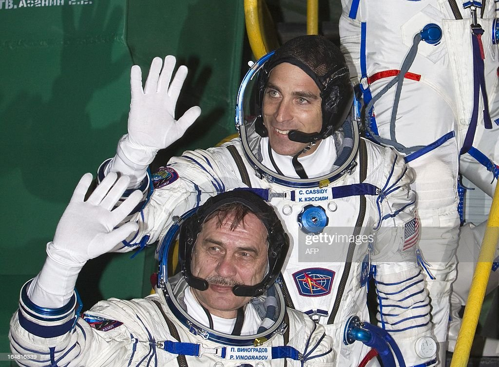 The International Space Station crew members US astronaut Chris Cassidy (Top) and Russian cosmonaut Pavel Vinogradov wave as they board the Soyuz TMA-08M spacecraft at the Russian-leased Baikonur cosmodrome on March 29, 2013. The three are set to blast off early on March 29 for the International Space Station (ISS) aboard a Soyuz TMA-08M spacecraft.