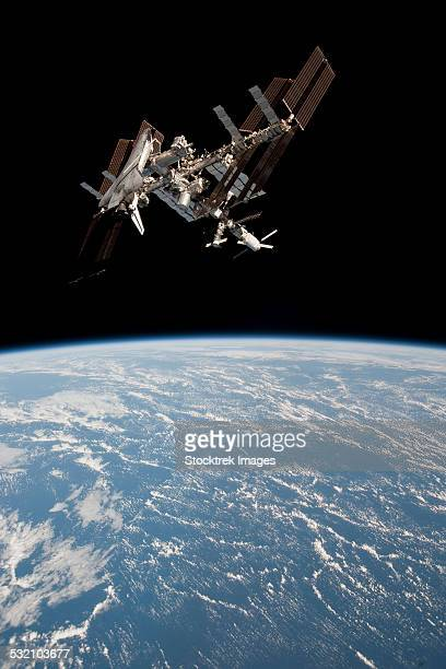 The International Space Station in orbit above Earth.