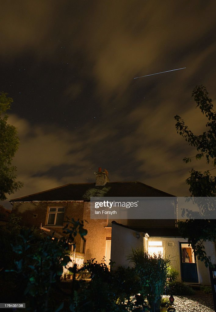The International Space Station passes over homes on August 12, 2013 in Saltburn, United Kingdom. The ISS passed over on the same evening as the Perseid Meteor shower was at its peak and was visible. During the peak of the meteor shower, the rate of meteors can reach 60 or more per hour. They can be seen all across the sky as they gradually fall away from the tail of the Swift-Tuttle comet.