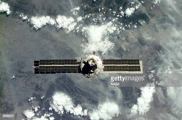 The International Space Station with its USbuilt Unity node facing the camera floats in orbit September 18 2000 following its undocking from the...