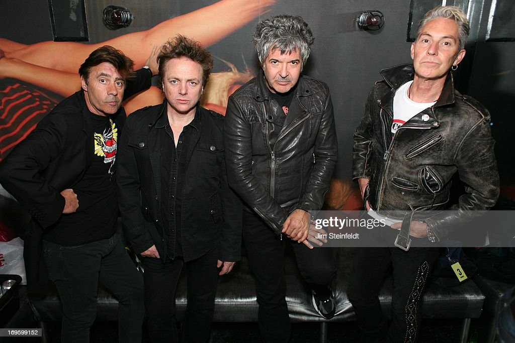 The International Swingers featuring (L-R) Glen Matlock (bass), James Stevenson (guitar), Clem Burke (drums) and Gary Twinn (vocals) pose for a portrait backstage at The Viper Room in Los Angeles, California on May 17, 2013.