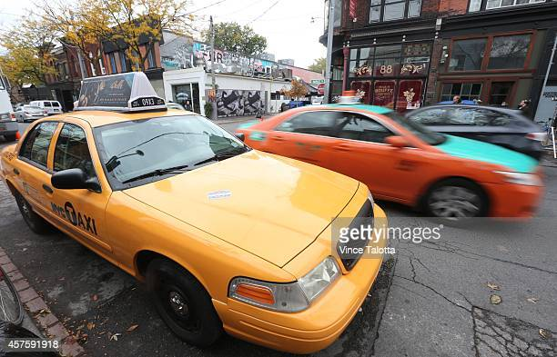 The intersection of Ossington and Argyle has been transformed into New York City today for the filming of Beauty and the Beast from police cars taxi...