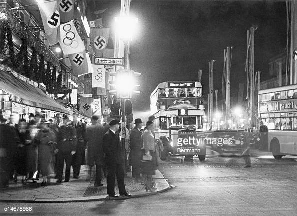 The intersection of Unter Den Linden and Freidrichstrasse in Berlin during the 1936 Olympic Games with both Nazi and Olympic flags hanging from...