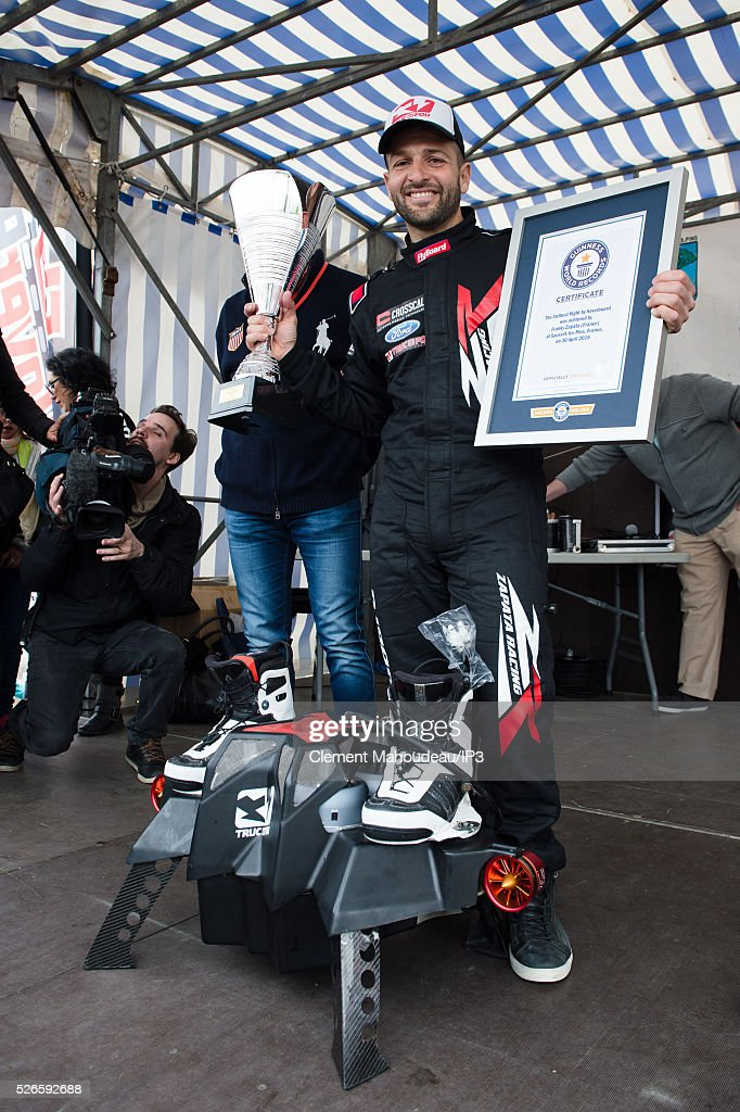 The inventor of a flying machine, Fly Board Air, Franky Zapata celebrates making new Guinness World Record for the furthest hover board flight on April 30, 2016 in Marseille, France. The Flyboard Air, with its company Zapata Racing (ZR), gives its first public demonstration allowing a man to fly by air propulsion. Zapata, the French jet ski champion who invented the Fly board Air, has set a new Guinness World Record for the furthest hover board flight. Zapata achieved the feat off the coast of Sausset-les-Pins in the south of France, riding his Fly board Air hover board for a distance of more than 2,252 meters (7,388) feet).