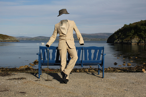 The Invisible Man in a Suit