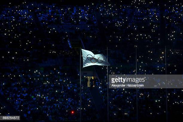 The IOC flag waves during the Closing Ceremony on Day 16 of the Rio 2016 Olympic Games at Maracana Stadium on August 21 2016 in Rio de Janeiro Brazil