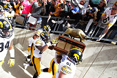 The Iowa Hawkeyes celebrate after their win over the Wisconsin Badgers at Camp Randall Stadium on October 03 2015 in Madison Wisconsin
