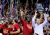 The Iowa State Cyclones celebrate with the trophy after their 70 to 66 win over the Kansas Jayhawks during the championship game of the Big 12...