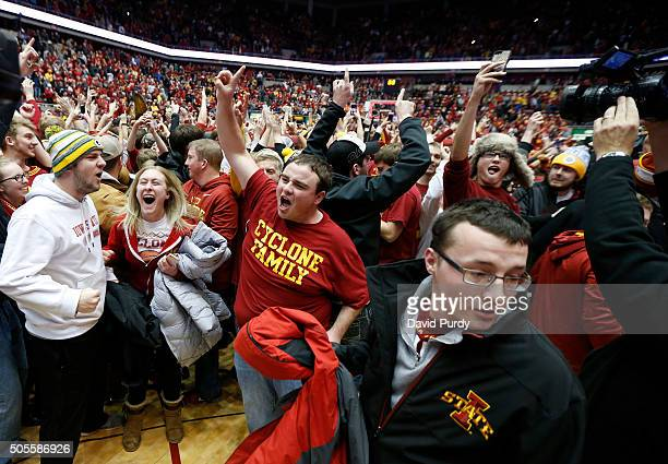 The Iowa State Cyclones fans storm the court after Iowa State defeated the Oklahoma Sooners 8277 at Hilton Coliseum on January 18 2016 in Ames Iowa...