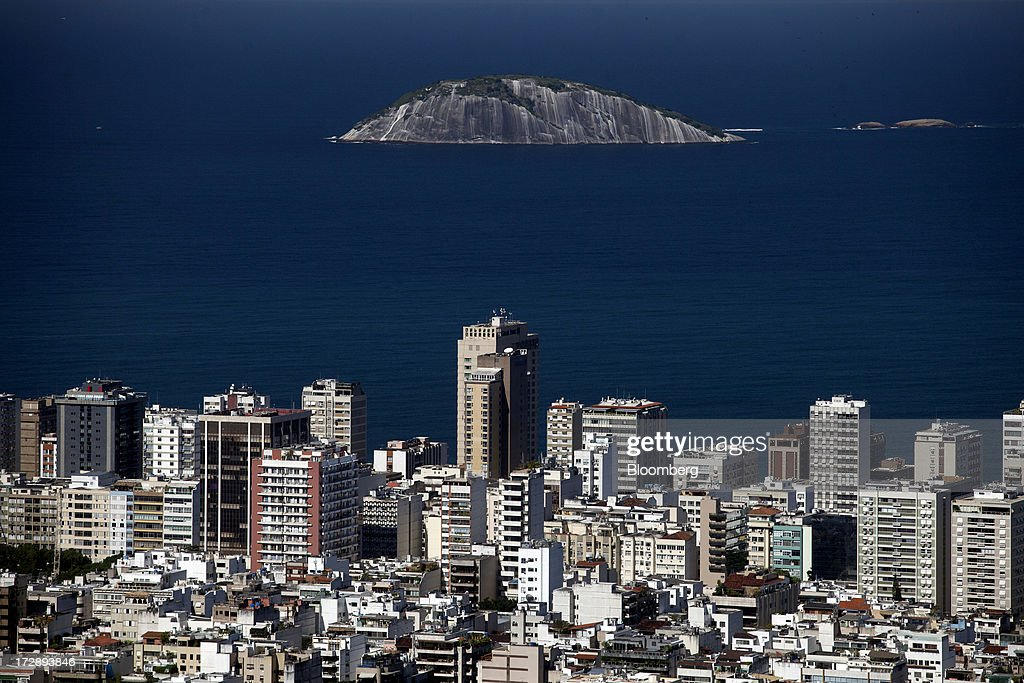 The Ipanema Beach skyline stands below one of the Cagarra Islands in this aerial photograph of Rio de Janeiro, Brazil, on Thursday, July 4, 2013. Brazils shorter-term swap rates fell after a report showed inflation slowed in June more than analysts forecast, damping speculation that the central bank will increase borrowing costs at a faster pace. Photographer: Dado Galdieri/Bloomberg via Getty Images