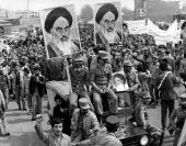 The Iranian Islamic Republic Army demonstrates in solidarity with people in the street during the Iranian revolution They are carrying posters of the...