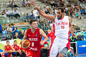 The iranian power forward Hamed Hadadi defends against a drive to the basket by The mexican guard Francisco Cruz in the match between Mexico and Iran...