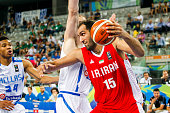 The iranian power forward Hamed Hadadi moves the ball to the basket in the match between Greece and Iran at 2016 FIBA Olympic Qualifying Tournament...