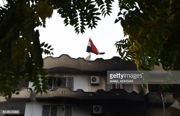 The Iraqi flag flies above the Iraqi embassy building after an attack in the Afghan capital Kabul on July 31 2017 A suicide bomber blew himself up...