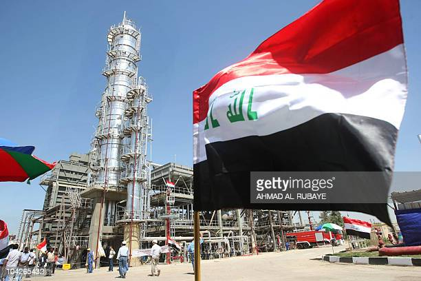 The Iraqi flag flutters during the official opening of the second refinery for crude oil in AlDora refinery complex in Baghdad on September 16 2010...
