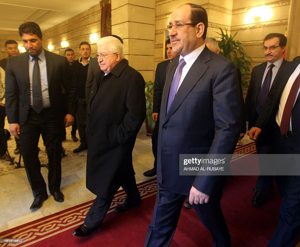 The Iraqi President <a gi-track='captionPersonalityLinkClicked' href=/galleries/search?phrase=Fuad+Masum&family=editorial&specificpeople=13415208 ng-click='$event.stopPropagation()'>Fuad Masum</a> (L) walks alongside Iraq's Vice President Nuri al-Maliki during a meeting in Baghdad's fortified Green Zone on January 14, 2015. The two sides discussed matters related to the financial budget of 2015. AFP PHOTO/AHMAD AL-RUBAYE